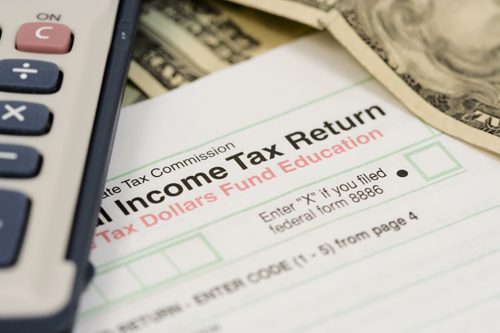 Picture of tax return form and money